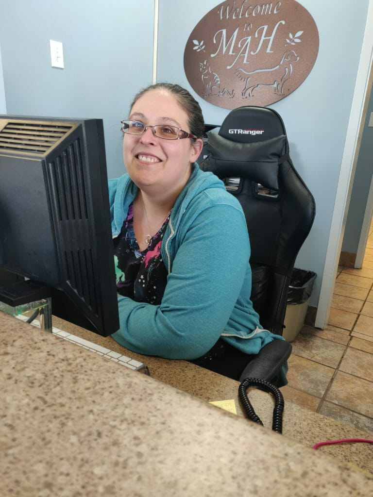Client care representative sitting behind computer